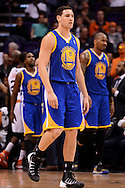 Dec 15, 2013; Phoenix, AZ, USA; Golden State Warriors guard Klay Thompson (11) walks off the court against the Phoenix Suns in the first half at US Airways Center. The Suns defeated the Warriors 106-102. Mandatory Credit: Jennifer Stewart-USA TODAY Sports