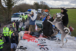 © Licensed to London News Pictures . 21/03/2014 . Barton Moss , Manchester , UK . Protesters watch over the road down which lorries from the iGas site need to pass . The Barton Moss anti-fracking demonstration camp today (Friday 21st March 2014) . Photo credit : Joel Goodman/LNP