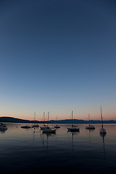 """Boats on Lake Tahoe 2"" - These boats were photographed at sunset from the West shore of Lake Tahoe, California."