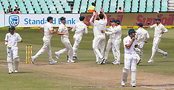 Durban. 040318.Mitchell Starc of Australia celebrate the wicket of Dean Elgar of the Proteas during day 4 of the 1st Sunfoil Test match between South Africa and Australia at Sahara Stadium Kingsmead on March 04, 2018 in Durban, South Africa