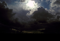 Storm clouds with figure & dog UK