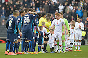 teams line up during the Sky Bet Championship match between Milton Keynes Dons and Queens Park Rangers at stadium:mk, Milton Keynes, England on 5 March 2016. Photo by Dennis Goodwin.