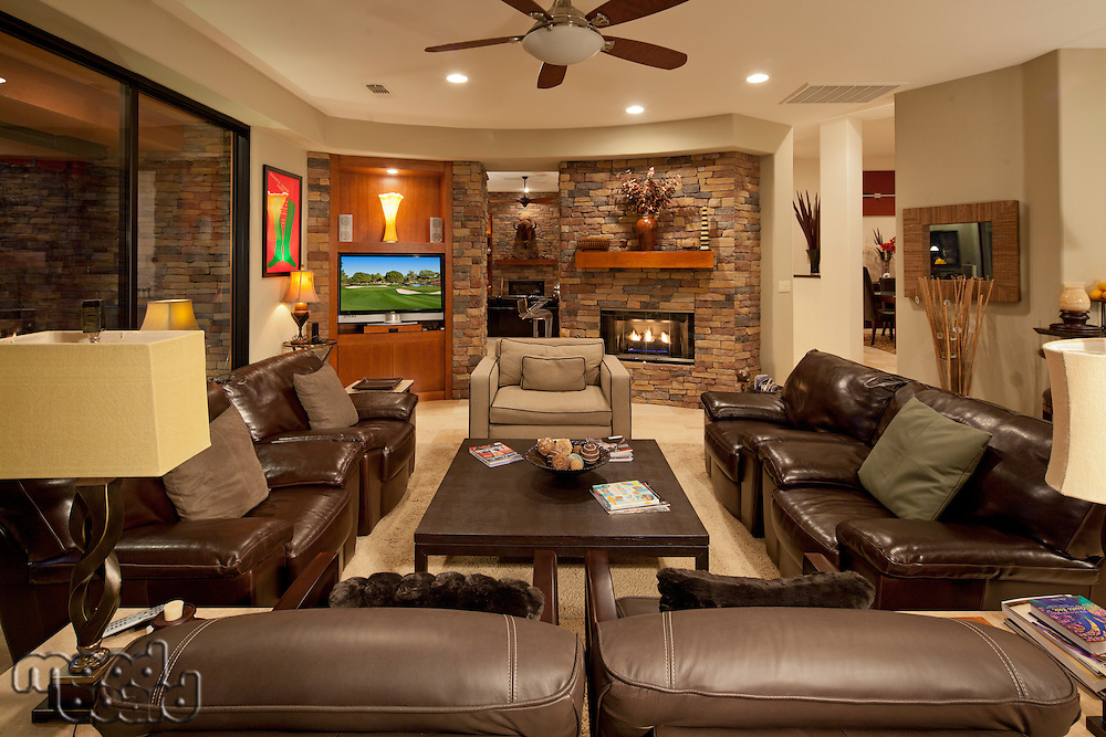 Leather seating furniture in living room of luxury mansion
