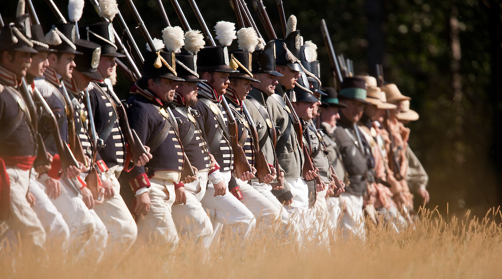 London, ONT.; October 1, 2011--  A line of American soldiers march into battle during a War of 1812 re-enactment at Fanshawe Pioneer Village in London, Ontario, October 1, 2011.<br /> <br /> (GEOFF ROBINS/ Postmedia News)
