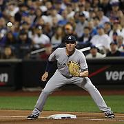 Greg Bird, New York Yankees, playing at first base during the New York Mets Vs New York Yankees MLB regular season baseball game at Citi Field, Queens, New York. USA. 20th September 2015. Photo Tim Clayton