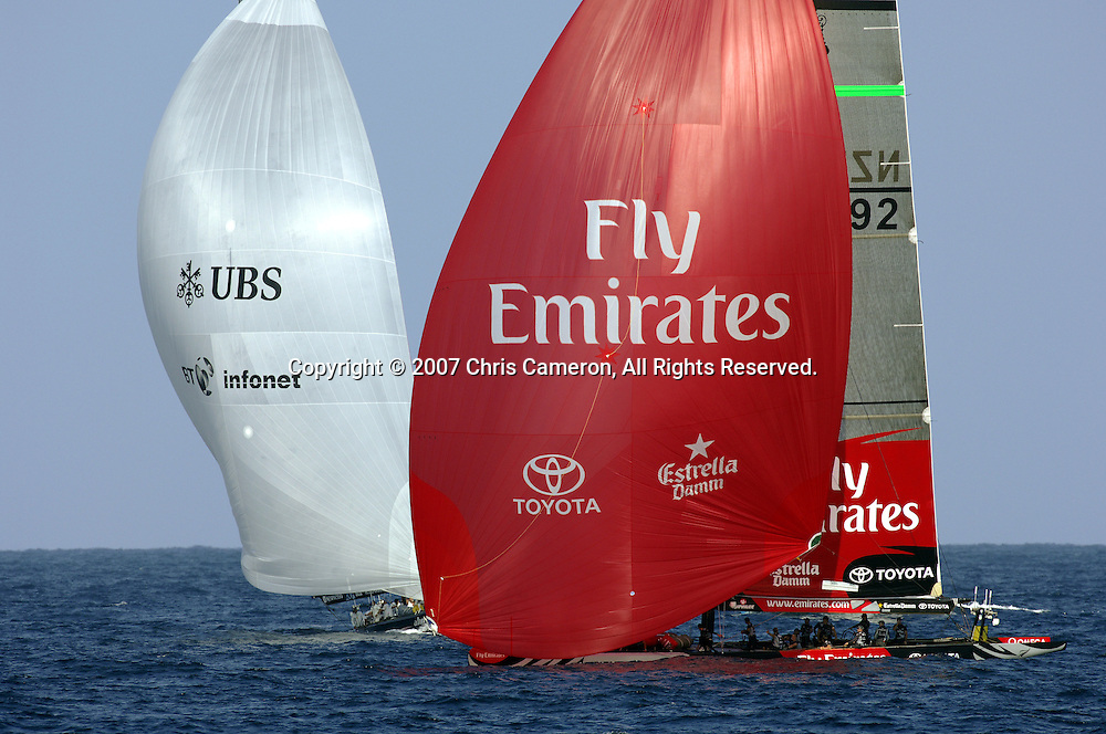 Emirates Team New Zealand NZL92 cross ahead of Alinghi SUI100 on the first run after a top mark rounding in race three of the 32nd America`s Cup in Valencia, Spain on Tuesday 26 June 2007. Team New Zealand won the match by 25 seconds. Photo : Chris Cameron/PHOTOSPORT