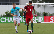 Portugal defender Gabriel Costa (4) dribbles the ball away from Slovenia midfielder Tom Kljun (13) during a CONCACAF boys under-15 championship soccer game, Sunday, August 11, 2019, in Bradenton, Fla. Portugal defeated Slovenia in the final in 2-0. (Kim Hukari/Image of Sport)