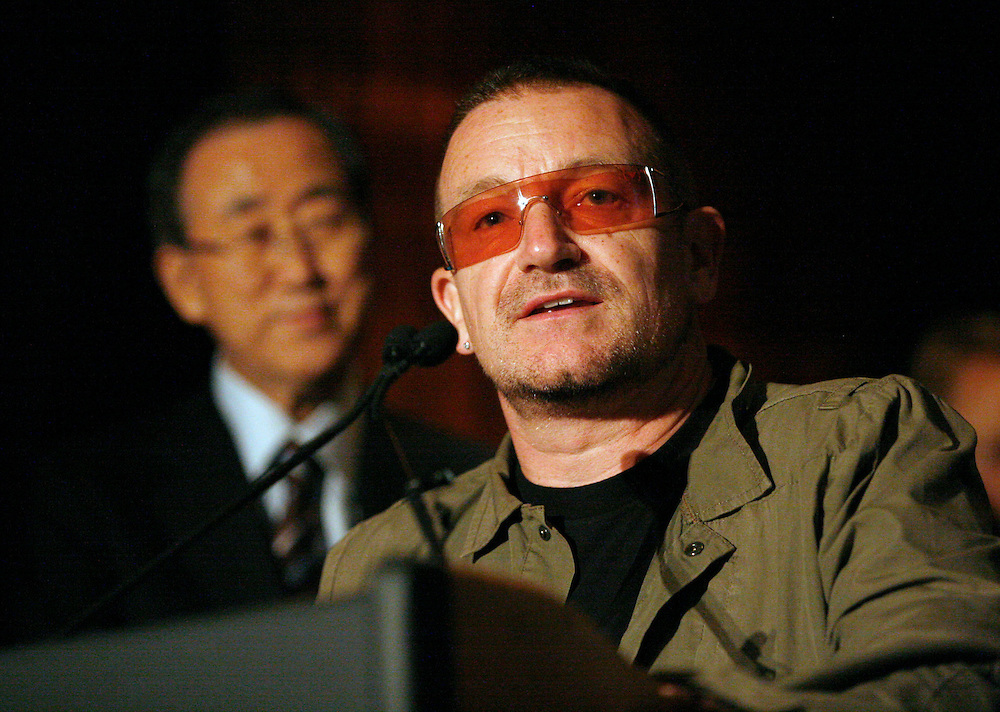 In this photo from the United  Nations Foundation, U2 lead singer and ONE campaign co-founder,  Bono, speaks as UN Secretary General Ban Ki-moon looks on, at The Four Seasons Restaurant in New York, Wednesday, Sept. 24, 2008. The two were featured speakers at a reception hosted by nine organizations including Millennium Promise and the United Nations Foundation, marking the half way point for the Millennium Development Goals. (Photo/United Nations Foundation/Stuart Ramson)