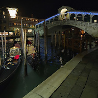 VENICE, ITALY - DECEMBER 08:  Gondolas lies near Rialto Bridge illuminated with Christmas lights on December 8, 2011 in Venice, Italy. HOW TO LICENCE THIS PICTURE: please contact us via e-mail at sales@xianpix.com or call our offices in London   +44 (0)207 1939846 for prices and terms of copyright. First Use Only ,Editorial Use Only, All repros payable, No Archiving.© MARCO SECCHI