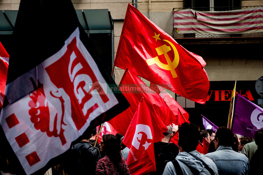 May 1, 2019 - Barcelona, Catalonia, Spain - Communist flags are seen  as workers march during  May Day rally in the center of Barcelona. (Credit Image: © Jordi Boixareu/ZUMA Wire)