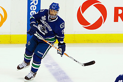 June 4, 2011; Vancouver, BC, CANADA; Vancouver Canucks center Manny Malhotra (27) warms up before game two of the 2011 Stanley Cup Finals against the Boston Bruins at Rogers Arena. Vancouver defeated Boston 3-2 in overtime. Mandatory Credit: Jason O. Watson / US PRESSWIRE