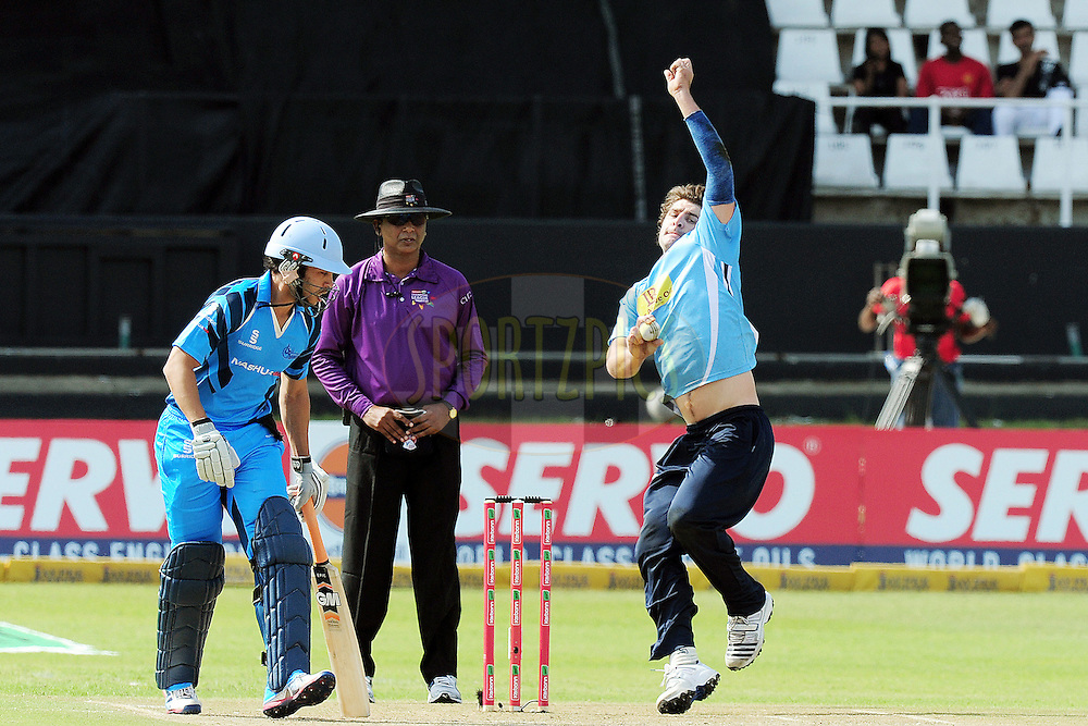 Colin de Grandhomme bowling during match 8 of the Karbonn Smart CLT20 South Africa between The Titans and The Auckland Aces held at Kingsmead Park in Durban, South Africa on the 17th October 2012..Photo by Gerhard Duraan/SPORTZPICS/CLT20