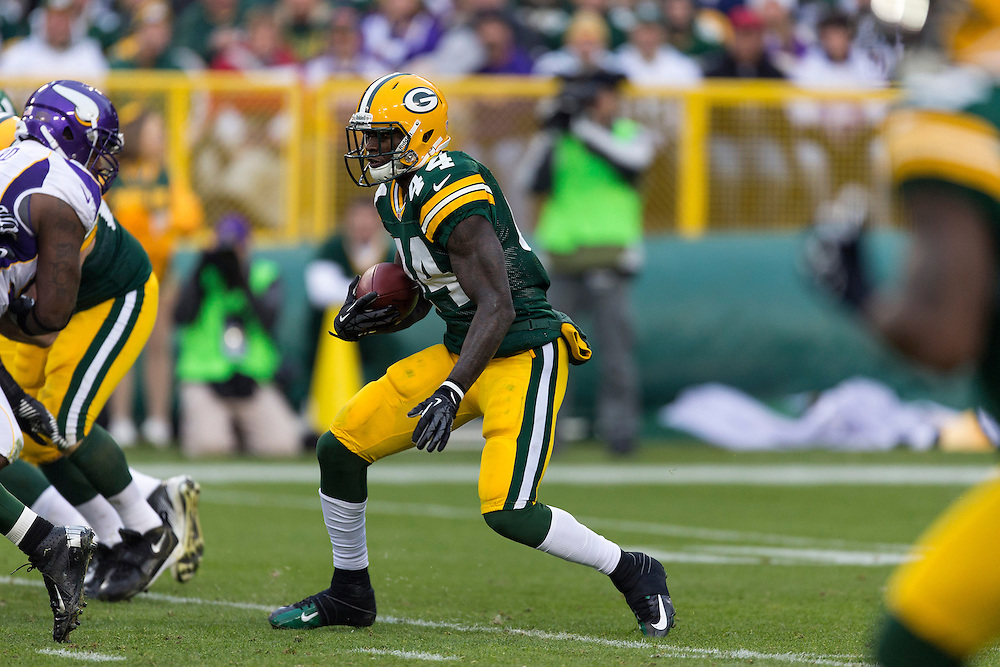 GREEN BAY, WI - DECEMBER 2:  James Starks #44 of the Green Bay Packers runs the ball against the Minnesota Vikings at Lambeau Field on December 2, 2012 in Green Bay, Wisconsin.  The Packers defeated the Vikings 23-14.  (Photo by Wesley Hitt/Getty Images) *** Local Caption *** James Starks