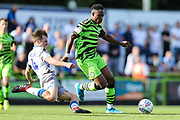 Colchester United's Tom Lapslie(4) tackles Forest Green Rovers Udoka Godwin-Malife(22) during the EFL Sky Bet League 2 match between Forest Green Rovers and Colchester United at the New Lawn, Forest Green, United Kingdom on 14 September 2019.