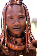 Namibia. OvaHimba woman portrait.  Muddy dreadlocks with copper necklaces. Nomadic tribes-woman..©Patrick King
