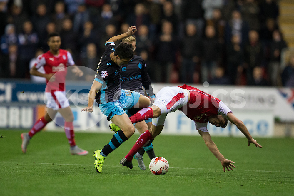 Fernando Forestieri of Sheffield Wednesday tackles Tony Andreu of Rotherham United during the Sky Bet Championship match between Rotherham United and Sheffield Wednesday at the Aesseal New York Stadium, Rotherham, England on 23 October 2015. Photo by James Williamson.