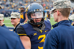 Dec 3, 2016; Morgantown, WV, USA; West Virginia Mountaineers quarterback Skyler Howard (3) shakes hands with active service members before his game against the Baylor Bears at Milan Puskar Stadium. Mandatory Credit: Ben Queen-USA TODAY Sports