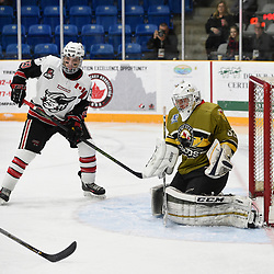"TRENTON, ON  - MAY 4,  2017: Canadian Junior Hockey League, Central Canadian Jr. ""A"" Championship. The Dudley Hewitt Cup. Game 5 between Powassan Voodoos and the Georgetown Raiders. Nate McDonald #33 of the Powassan Voodoos protects the crease from Josh Dickinson #28 of the Georgetown Raiders during the first period.<br /> (Photo by Andy Corneau / OJHL Images)"