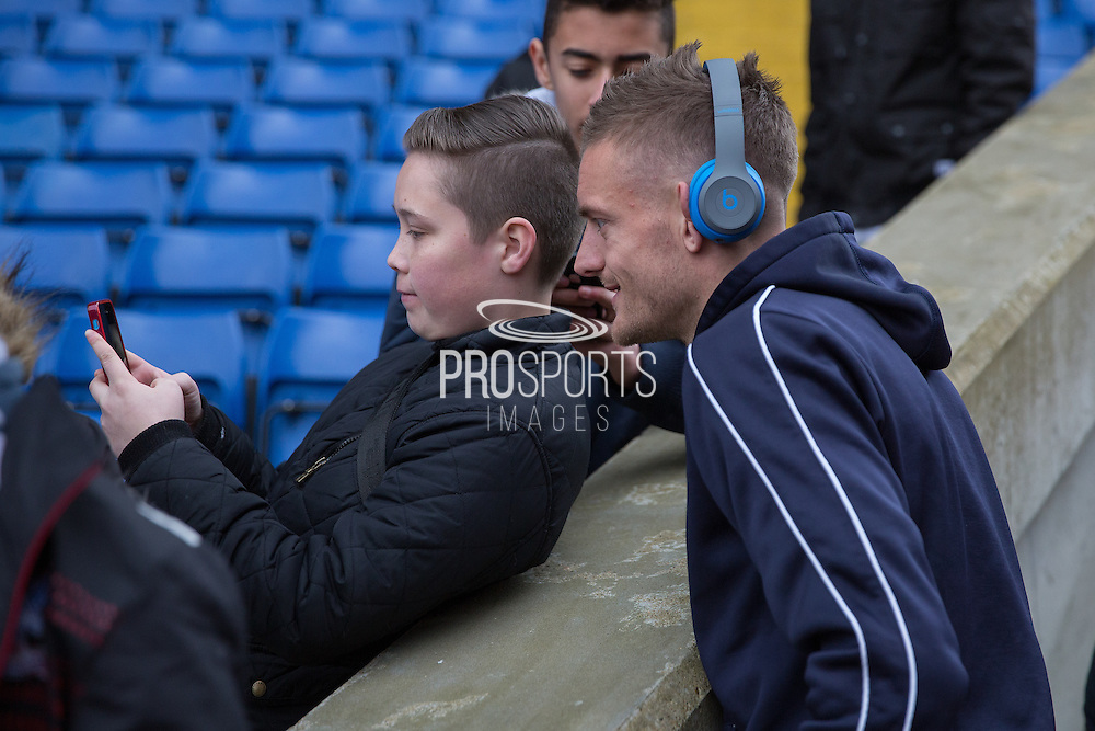 Leicester City forward Jamie Vardy (9) has a selfie with a young fan before the Barclays Premier League match between Crystal Palace and Leicester City at Selhurst Park, London, England on 19 March 2016. Photo by Phil Duncan.