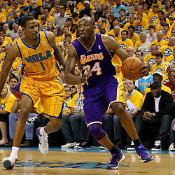April 22, 2011; New Orleans, LA, USA; Los Angeles Lakers shooting guard Kobe Bryant (24) drives past New Orleans Hornets small forward Trevor Ariza (1) during the second half in game three of the first round of the 2011 NBA playoffs at the New Orleans Arena. The Lakers defeated the Hornets 100-86.   Mandatory Credit: Derick E. Hingle