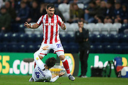 Stoke City forward Scott Hogan (20) tangles with Preston North End midfielder Ben Pearson (4) during the EFL Sky Bet Championship match between Preston North End and Stoke City at Deepdale, Preston, England on 21 August 2019.