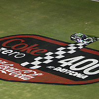 NASCAR Sprint Cup driver Denny Hamlin (11) spins through the infield during the NASCAR Coke Zero 400 Sprint series auto race at the Daytona International Speedway on Saturday, July 6, 2013 in Daytona Beach, Florida.  (AP Photo/Alex Menendez)