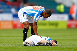 Lee Peltier of Huddersfield is checked out by Lee Peltier after taking a knock - Photo mandatory by-line: Rogan Thomson/JMP - 07966 386802 - 13/09/2014 - SPORT - FOOTBALL - Huddersfield, England - The John Smith's Stadium - Huddersfield town v Middlesbrough - Sky Bet Championship.