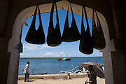 Hand bags hanging for sale at a store in Lamu, Kenya.