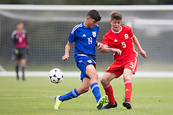 WREXHAM, WALES - Tuesday, August 13, 2019: Wales' Ethan Hartness and Cyprus' Lambros Constantine during the UEFA Under-15's Development Tournament match between Wales and Cyprus at Colliers Park. (Pic by Paul Greenwood/Propaganda)