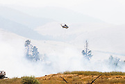 A fire helicopter flies over a burning brush fire in Montana. Missoula Photographer, Missoula Photographers, Montana Pictures, Montana Photos, Photos of Montana