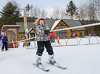 With a 0-14mpg blast Elizabeth Gagne holds on tight as she loads the rope tow at the Abenaki Ski Area in Wolfeboro.  (Karen Bobotas/for the Laconia Daily Sun)