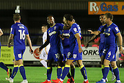 AFC Wimbledon striker Dominic Poleon (10) scores a goal 3-0 and celebrates during the EFL Trophy match between AFC Wimbledon and U23 Swansea City at the Cherry Red Records Stadium, Kingston, England on 30 August 2016. Photo by Stuart Butcher.