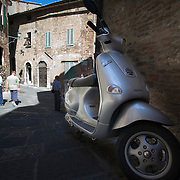 Vespa ET4 parked on street in the hilltown of Montepulciano, Tuscany, Italy<br />