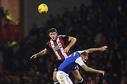 Jack O'Connell of Sheffield United beats Jordan Rhodes of Sheffield Wednesday to a header - Mandatory by-line: Robbie Stephenson/JMP - 12/01/2018 - FOOTBALL - Bramall Lane - Sheffield, England - Sheffield United v Sheffield Wednesday - Sky Bet Championship