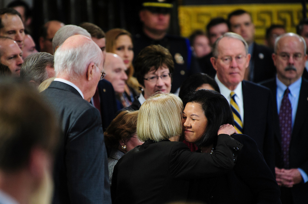 IRENE HIRANO INOUYE is greeted by Senators in the Capitol Rotunda on Thursday during a service and public viewing of her husband, the late Senator Daniel Inouye (D-HI) who passed away at the age of 88 on December 18 at the Walter Reed National Military Medical Center in Bethesda, Md. Inouye, 88, a decorated World War II veteran and the second-longest serving senator in history will lie in state until Friday when a memorial service will be held at the National Cathedral.