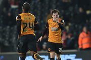 Hull City defender Andrew Robertson (26)  points at Hull City midfielder Sone Aluko (24) in celebration just after he scored for hull to go 1 all  during the Sky Bet Championship match between Hull City and Nottingham Forest at the KC Stadium, Kingston upon Hull, England on 15 March 2016. Photo by Ian Lyall.