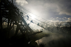 """©  London News Pictures. 27/01/2013.  Competitors passing a rope bridge as they are pushed to the limits  in the 2013 Tough Guy Challenge on January 27, 2013 in Wolverhampton, England. The event has been widely described as """"the toughest race in the world"""", with over one-third of the starters failing to finish in a typical year. Photo credit: Ben Cawthra"""