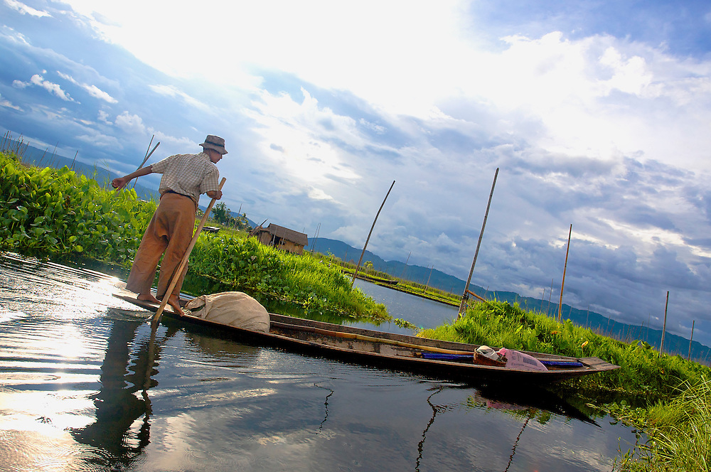 Rowing in the canal, Inle Lake, Myanmar.