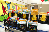 Student packets arranged alphabetically ready to be picked up at Elm Street School on Friday.  (Karen Bobotas/for the Laconia Daily Sun)