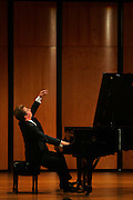METRO - Alexy Koltakov of Ukraine finishes with a flourish as he performs Liszt's Sonata in B minor S.178 Friday, October 20, 2006 during the San Antonio International Piano Competition held at Ruth Taylor Concert Hall on the Trinity University campus. BAHRAM MARK SOBHANI/STAFF