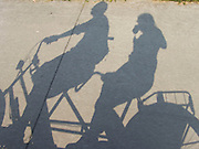 shadow of tandem bicycle with two people on it