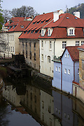 View of the Grand priory Mill and water wheel in the Devil's Stream (Certovka) in the Little Quarter of Prague, Czech Republic. The mill was built by the the Knights of Malta during the middle ages.