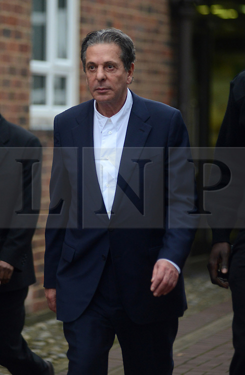 © Licensed to London News Pictures. 28/11/2013. London, UK. Millionaire art dealer Charles Saatchi, leaving Isleworth Crown Court where a case his being heard against his two former personal assistants, who are accused of misappropriating over £600,00 of funds while working for Charles Saatchi and his former wife Nigella Lawson .Photo credit : Peter Kollanyi/LNP