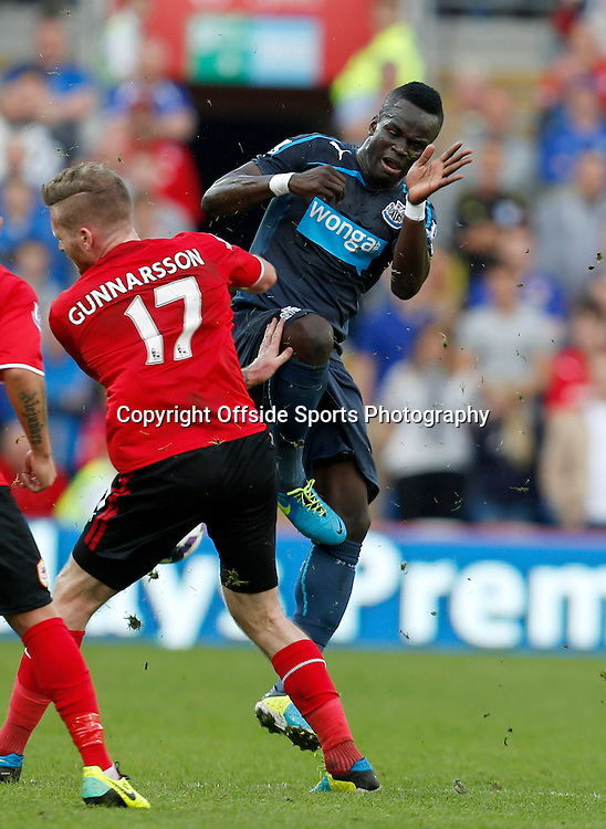 5th October 2013- Barclays Premier League - Cardiff City Vs Newcastle United -  Aron Gunnarsson of Cardiff City and Moussa Sissoko of Newcastle United clash - Photo: Paul Roberts / Offside.