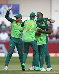 June 28, 2019 - Chester Le Street, County Durham, United Kingdom - Kagiso Rabada celebrates with his team mates after claming the wicket of Sri Lanka Dimuth Karunaratne first ball during the ICC Cricket World Cup 2019 match between Sri Lanka and South Africa at Emirates Riverside, Chester le Street on Friday 28th June 2019. (Credit Image: © Mi News/NurPhoto via ZUMA Press)