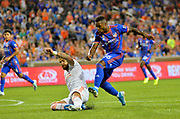 Joseph-Claude Gyau (36) of FC Cincinnati shoots the ball past Leandro Gonzalez Pirez (5) of Atlanta United FC during a MLS soccer game, Wednesday, September 18, 2019, in Cincinnati, OH. Atlanta defeated Cincinnati 2-0. (Jason Whitman/Image of Sport)