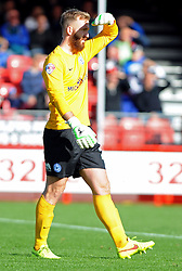 Peterborough United's Ben Alnwick shields eyes from sun - photo mandatory by-line David Purday JMP- Tel: Mobile 07966 386802 - 11/10/14 - Crawley Town v Peterbourgh United - SPORT - FOOTBALL - Sky Bet Leauge 1  - London - Checkatrade.com Stadium