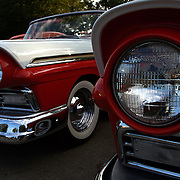 . Cars and their owners were in Des Moines over the 4th of July weekend for the Good Guys 16th Heartland Nationals held at the Iowa State Fairgrounds, bringing over 3,500 of the country?s hottest rods and coolest customs to Iowa?s Capital City.  ..Sharing space next to each other were two 1957 Ford Fairlane Convertibles...Exhibitors are very skilled, multi-talented craftsmen. They dedicate thousands of hours to bring their hot rod or custom  autos to a high standard. Unlike many car shows the Good Guys usually drive both to and from the event...Photo by David Peterson