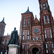 . Statue of the Smithsonian Insitution's founder, James Smithson, in front of the Smithsonian Castle on the National Mall in Washington DC. Originally housing exhibit and public engagement space, the Smithsonian Castle is now mostly devtoted to the organization's administrative operations.