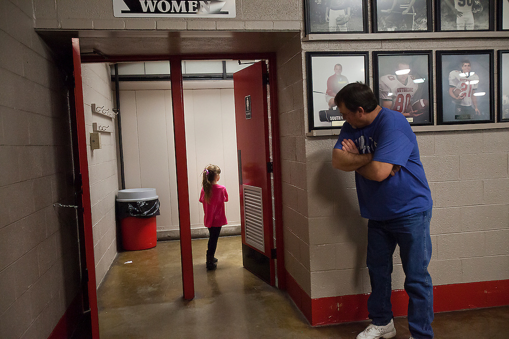 Dale leaned in to watch Kiera walk into the women's restroom during a Southridge boys basketball game at Memorial Gym in Huntingburg Jan. 31.